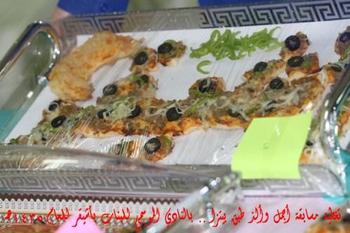 صورة تغطية مسابقة ( أجمل وألذ طبق بيتزا) بالنادي الموسمي للبنات بأشيقر